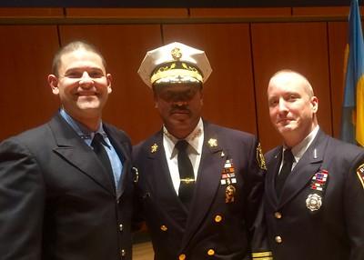 Jason Batz & Lt. Rehr poses with PFD commish Derrick Sawyer.