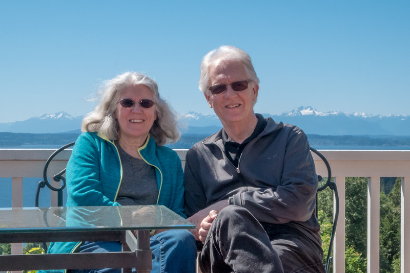 Sandi and I on the deck of our rental in West Seattle. Puget Sound and the Olympic Mountains in the background.