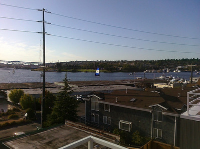 Lake Union with sailboat and Gas Works Park in the distance.