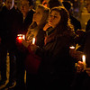Young women hold candles in St. Peter's Square as the period of Sede Vacante begins Feb. 28.  Pilot photo/Gregory L.  Tracy