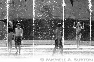 Playing in the Fountain at Heritage Park Olympia, WA  August 11, 2014