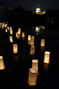 Peace Lanterns on the edge of Capitol Lake with the Capitol Building in the background