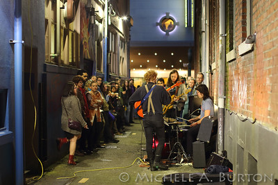 Band playing during 2017 Spring Arts Walk in the alley opposite the Washington Center
