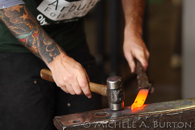Blacksmith Kelly Rigg demonstrates the art of traditional metal working at a workshop at the Arbutus Folk School  Olympia, WA October 25, 2014