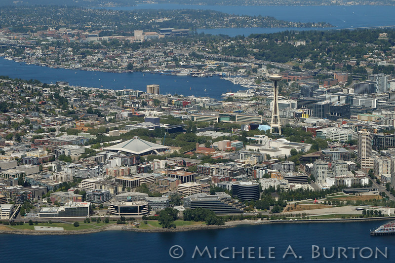 Aerial view of Seattle looking North. The Space Needle and Seattle Center are in the foreground. The University of Washington is at the top of the photo.