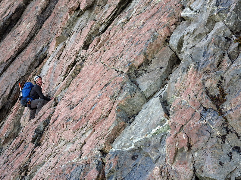 Steve on a steep traverse to gain the West Ridge of Malte
