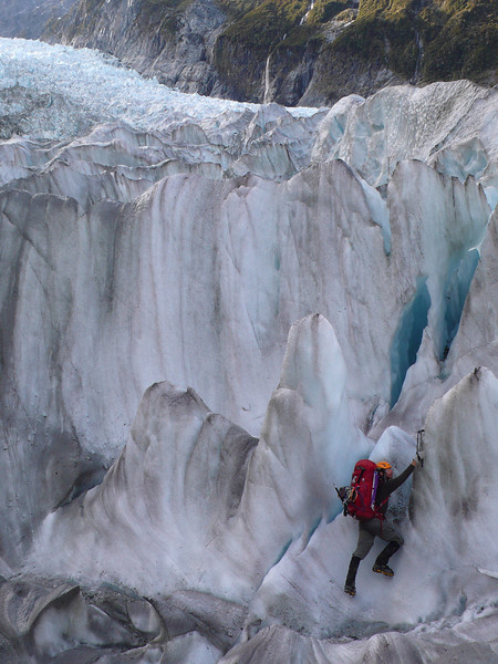 Danilo ice climbs on the descent back to the Fox terminus