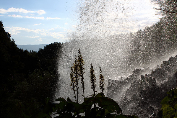 This shot is from behind the waterfall, looking down the valley into which the river flows.