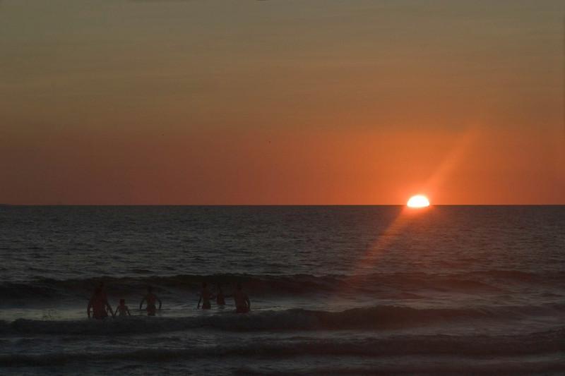 Enjoying a swim at sunset.