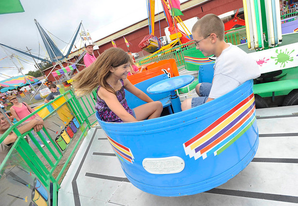 """Mikayla Hofer,13, and brother Michael, 11, of Patton get dizzy on the """"Tub of Fun"""" at the Cambria County Fair in Ebensburg, Monday, Sept.3, 2012.(AP Photo/Tribune-Democrat, John Rucosky)."""