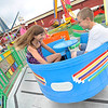 "Mikayla Hofer,13, and brother Michael, 11, of Patton get dizzy on the ""Tub of Fun"" at the Cambria County Fair in Ebensburg, Monday, Sept.3, 2012.(AP Photo/Tribune-Democrat, John Rucosky)."