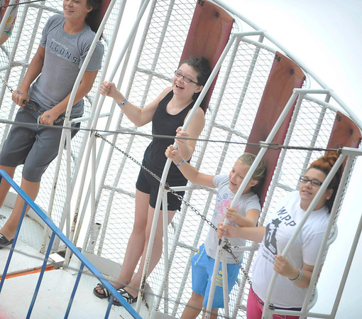 """From left riding the """"Inferno"""" at the Cambria County Fair in Ebensburg are Sterling Bard,13, of Warfordsburg, Alexis Daughenbaugh,12, of Twin Rocks, Marah Ketchock, 8, of Revloc, and Rose Verrelli,15, of Fallen Timber, Monday, Sept.3, 2012."""