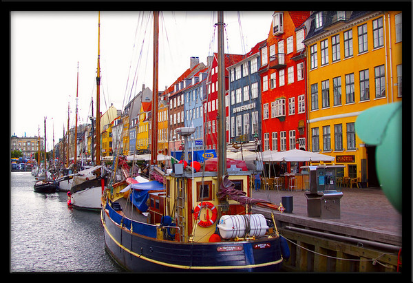 Boats moored in a canal just off Nyhavn Harbour in Copenhagen.