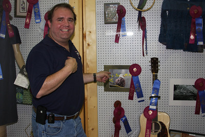 Gary Cox pointing to Best of Show picture at Delta Fair.   This photo also won first place in the Animal category!