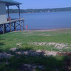 The lake is so low.  Water level should be almost to the deck of the boat house.