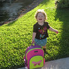 Elena's First Day of School at Wesleyan Weekday Schools.  She did not want to hold the backpack for the picture, or let it sit on the ground.