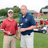 Kevin Gordon of Troy Fire Department and Mark Mason of Troy Police Department talk golf clubs as they prepare to play golf at Frear Park to benefit Cloth-A-Child Friday, August 30, 2013 in Troy, N.Y.. (J.S.CARRAS/THE RECORD)