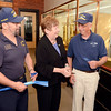 Bart Hutching of Orland, ME., Michele Vennard, President & CEO of Albany County Convention and Visitors Bureau and Wayne Van Amburgh of Castleton cut ribbon during  ceremony for USS Albany brass model exhibit at Albany County Convention and Visitors Bureau Monday, September 9, 2013 in Albany, N.Y.. (J.S.CARRAS/THE RECORD)