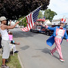 Ernest cannon of Lansingburgh waves flag as Fred Polnisch a.k.a. Uncle Sam passes by in the 38th annual Uncle Sam Parade Sunday, September 15, 2013 on Fifth Avenue in Lansingburgh, N.Y.. (J.S.CARRAS/THE RECORD)