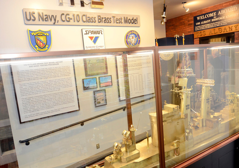 Ribbon cutting ceremony for USS Albany brass model exhibit at Albany County Convention and Visitors Bureau Monday, September 9, 2013 in Albany, N.Y.. (J.S.CARRAS/THE RECORD)