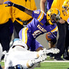 Unidentified Rhode Island player tackles UAlbany's Kevin Chillis (9) on a kick return during first quarter of college football action Saturday, September 14, 2013 at Bob Ford Field on the UAlbany Campus in Albany, N.Y.. (J.S.Carras/The Record)