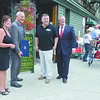 Jen and Lou Marchese are joind by Congressman Paul Tonco, (second from left) and Troy Mayor Lou Rosamilia (r) during celebration fo Manory's 100th year in buisness Thursday, August 29, 2013 in Troy, N.Y.. (J.S.Carras/The Record)