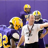 Troy High School football coach Mark Galuski works with defensive players inside during high school football practice due to heat index Wednesday, September 11, 2013 in Troy, N.Y.. (J.S.CARRAS/THE RECORD)