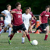Lansingburgh's dakota Franklin (14) moves ball haead of Cohoes defender Bryan Thieu (8)  during first half of high school boys soccer action Monday, September 9, 2013 at Cohoes High School in Cohoes, N.Y.. (J.S.CARRAS/THE RECORD)