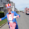 Fred Polnisch a.k.a. Uncle Sam reaches out to parade goers as the Uncle Sam Chorus follows behind during the 38th annual Uncle Sam Parade Sunday, September 15, 2013 on Fifth Avenue in Lansingburgh, N.Y.. (J.S.CARRAS/THE RECORD)