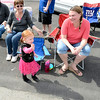 Susan Ward of Lansingburgh (l) looks on as her granddaughter Alayna Bush waves and Alayna's mother Jennifer Bush of Speigletown looks on at right during the 38th annual Uncle Sam Parade Sunday, September 15, 2013 on Fifth Avenue in Lansingburgh, N.Y.. (J.S.CARRAS/THE RECORD)