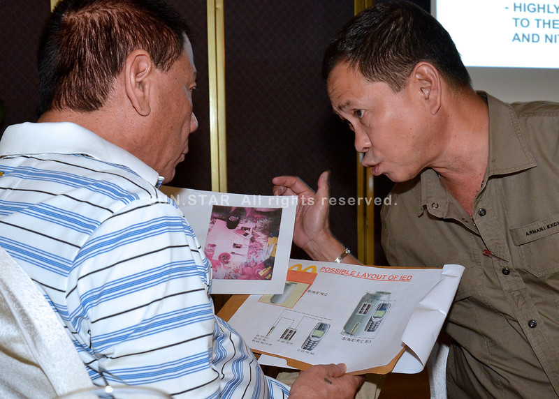 Davao City Mayor Rodrigo Duterte receives copies of CCTV footages on Davao twin blasts
