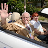 The 38th annual Uncle Sam Parade Grand Marshal Chris Lambertsen waves to the crowd as Susan Dwyer drives Sunday, September 15, 2013 on Fifth Avenue in Lansingburgh, N.Y.. (J.S.CARRAS/THE RECORD)