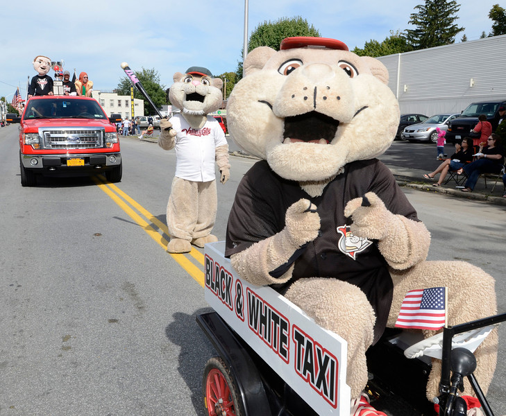 Tri-City ValleyCats mascots SouthPaw and Pappy along with New York Penn League championship trophy during the 38th annual Uncle Sam Parade Sunday, September 15, 2013 on Fifth Avenue in Lansingburgh, N.Y.. (J.S.CARRAS/THE RECORD)