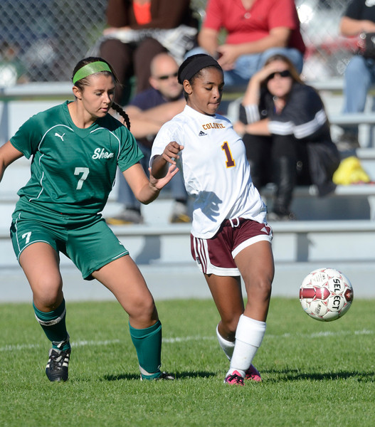 Shenendehowa's Sarah Jane Phillips (7) and Colonie's Dev Baskerville (1) battle for the ball during first half of high school girls soccer action Tuesday, September 17, 2013 at Colonie High School, in Colonie, N.Y.. (J.S.CARRAS/THE RECORD)
