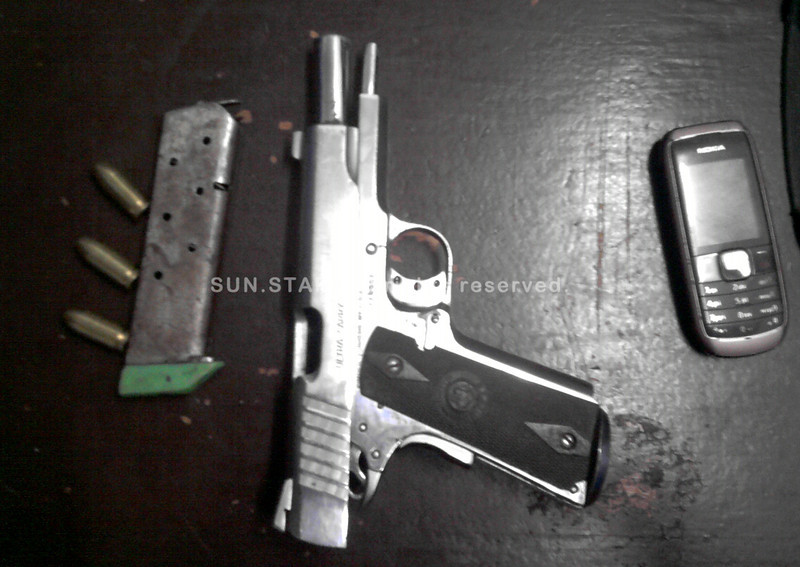 Handgun, ammunition, cellphone recovered from murder suspect in Cebu City