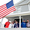Members of the Lance family gather under the flag during the 38th annual Uncle Sam Parade Sunday, September 15, 2013 on Fifth Avenue in Lansingburgh, N.Y.. (J.S.CARRAS/THE RECORD)