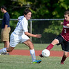 Lansingburgh's Pat Fleming attempts to move the ball ahead of Cohoes Colman Reardon (21) during first half of high school boys soccer action Monday, September 9, 2013 at Cohoes High School in Cohoes, N.Y.. (J.S.CARRAS/THE RECORD)