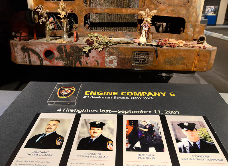 "Four firefighters FDNY Engine Company 6 on 49 Beekman Street who were lost in 9-11 attack are pictured (l-r) Lt. Thomas O'Hagan, firefighter Thomas P. Holohan, firefighter Paul Beyer and firefighter William ""Billy"" Johnson in front of remains of Engine 6 at  New York State Museum as part of September 11th display Tuesday, September 10, 2013 in Albany, N.Y.. (J.S.CARRAS/THE RECORD)"