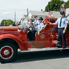Members of Troy Professional Firefighters Association ride on 1947 Mack fire truck during the 38th annual Uncle Sam Parade Sunday, September 15, 2013 on Fifth Avenue in Lansingburgh, N.Y.. (J.S.CARRAS/THE RECORD)