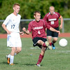 Lansingburgh defender Nick Cioffi (4) moves ball away from Cohoes Matthew Bluteau (17) during first half of high school boys soccer action Monday, September 9, 2013 at Cohoes High School in Cohoes, N.Y.. (J.S.CARRAS/THE RECORD)