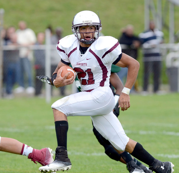 Lansingburgh's Anthony Walker (21) carries ball into the end zone against Green Tech during first quarter of high school football action Saturday, September 14, 2013 at Bleecker Stadium, in Albany, N.Y.. (J.S.CARRAS/THE RECORD)