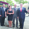 (l-r) Bill Sullivan, director of sales for Freihofer's, Lou and Jen Marchese owners of Manory's, Congrssman PaulTonko and Troy Mayor Lou Rosamilia stand in front of horse drawn delivery cart to celebrate 100th anniversary of Manory's Thursday, August 29, 2013 in Troy, N.Y.. (J.S.Carras/The Record)
