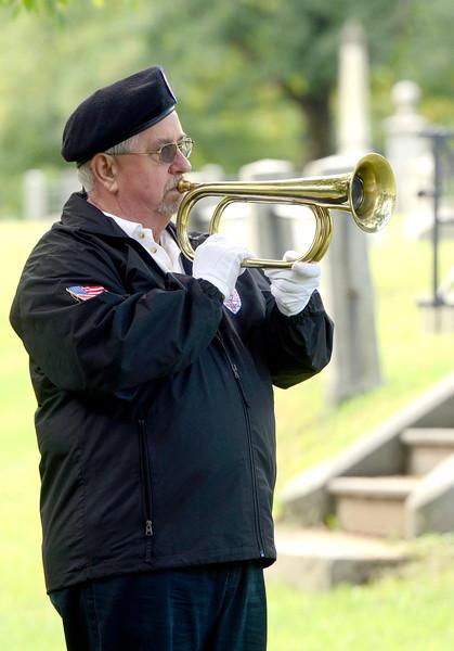 Veterans of Lansingburgh member Ken Mirocki plays TAPS during 55th Memorial Anniversary honoring Uncle Sam Wilson of Troy, N.Y., Saturday, September 14, 2013 in Oakwood Cemetery in Troy, N.Y.. (J.S.CARRAS/THE RECORD)