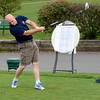 Troy Police officer Mark Maloy tees off at Frear Park to benefit Cloth-A-Child Friday, August 30, 2013 in Troy, N.Y.. (J.S.CARRAS/THE RECORD)