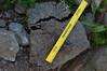 Broken up chunk of asphalt almost a foot diameter