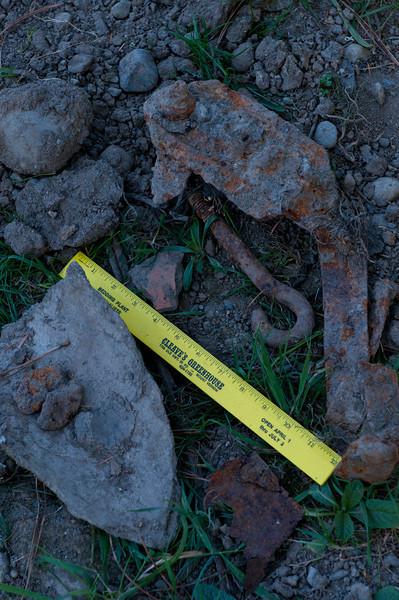 large cement chunk plus rocks and metal debris