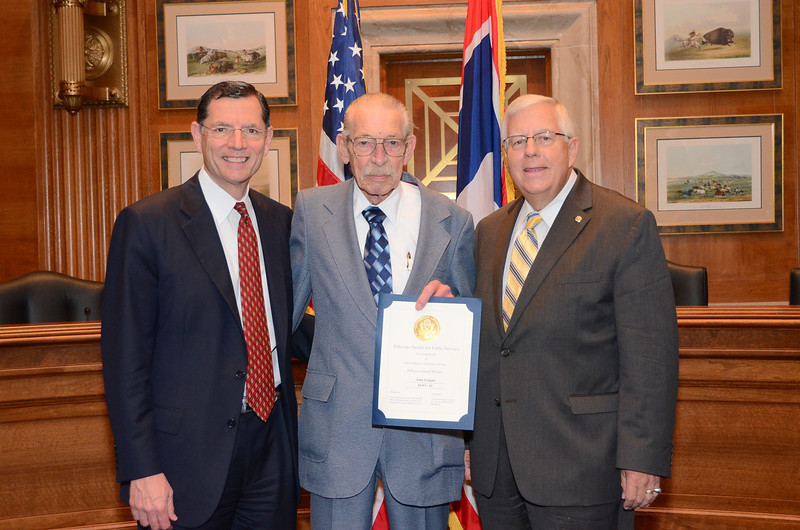 A Senior Corps volunteer, John Urbigkit of Cheyenne,WY, accepts the Jefferson Award for Public Service with Senators Barrasso and Enzi. Urbigkit serves as a Foster Grandparent at Triumph High School. (Photo courtesy of KCWY13)