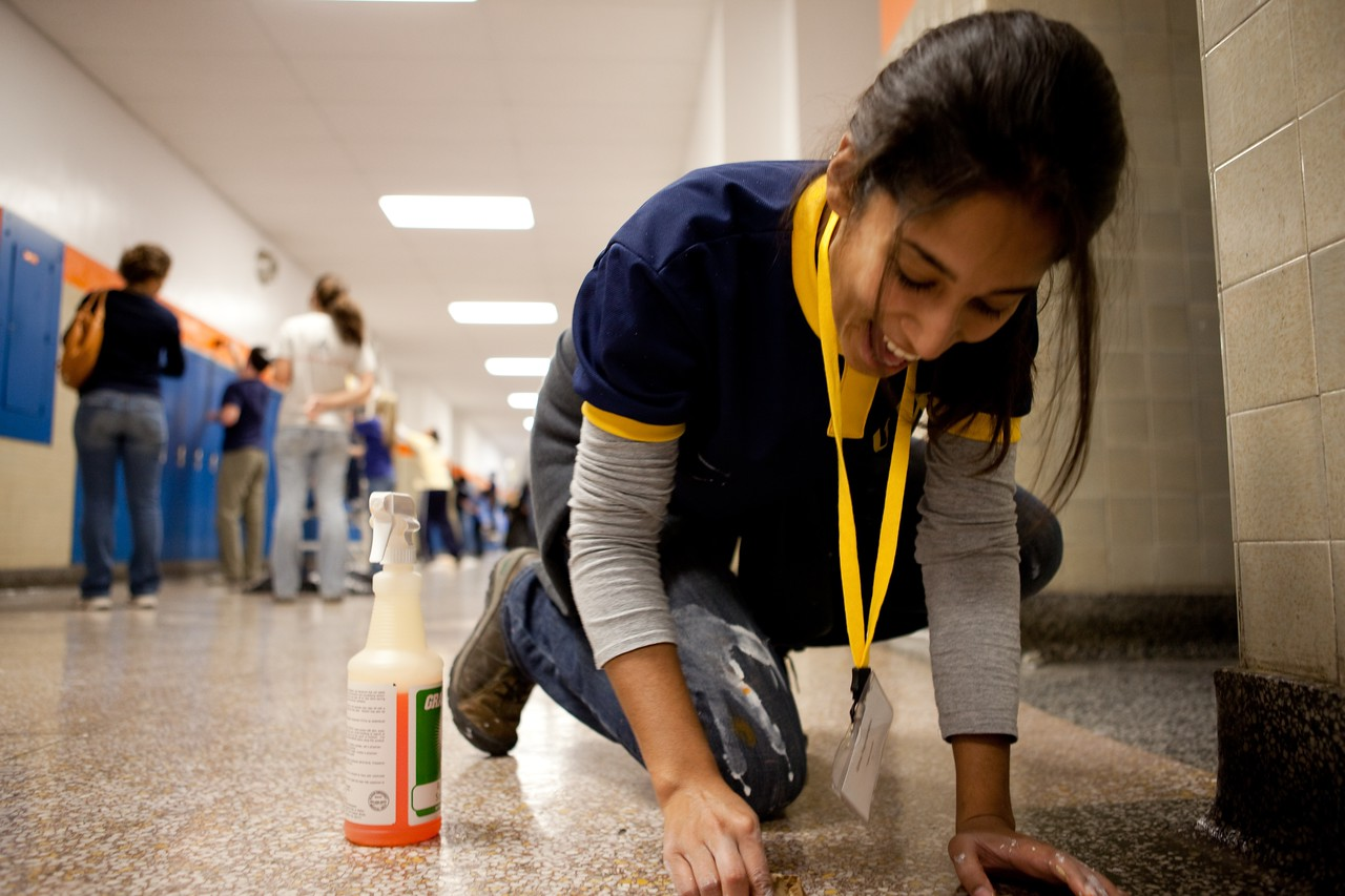 A George Washington University student participates in the school's Freshman Day of Service at a local school. Each year, the day is timed to coincide with the September 11th National Day of Service and engages the entire incoming freshman class in service projects throughout the Washington, DC, area.
