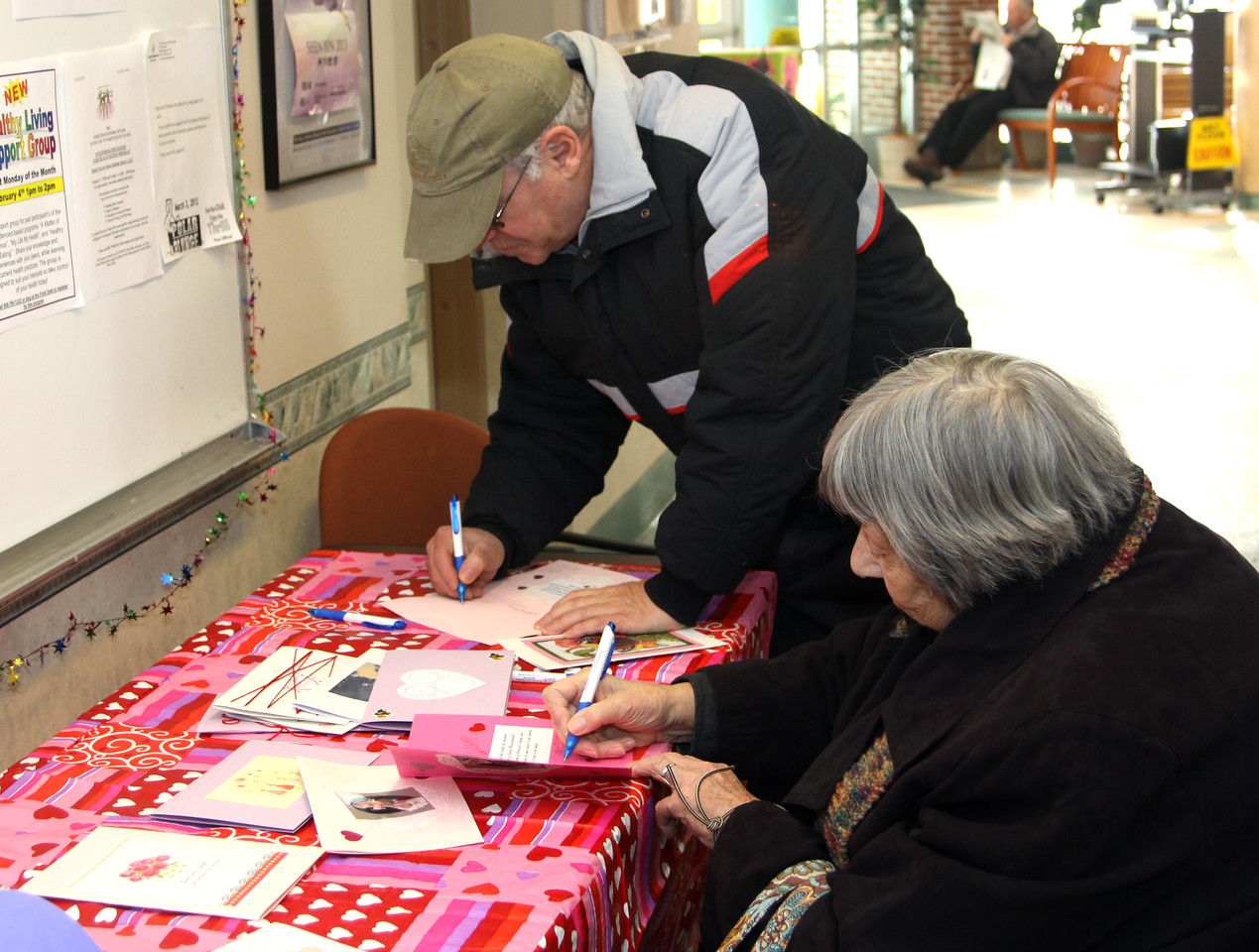 Seniors work on some of the 180 volunteer-created Valentines destined for U.S. Embassies and Marine Embassy Guard Posts during an RSVP event at the Worcester (MA) Senior Center.