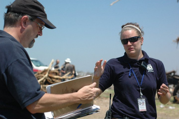 Quinn Gardner, right, directs a group of volunteers in Joplin, MO.